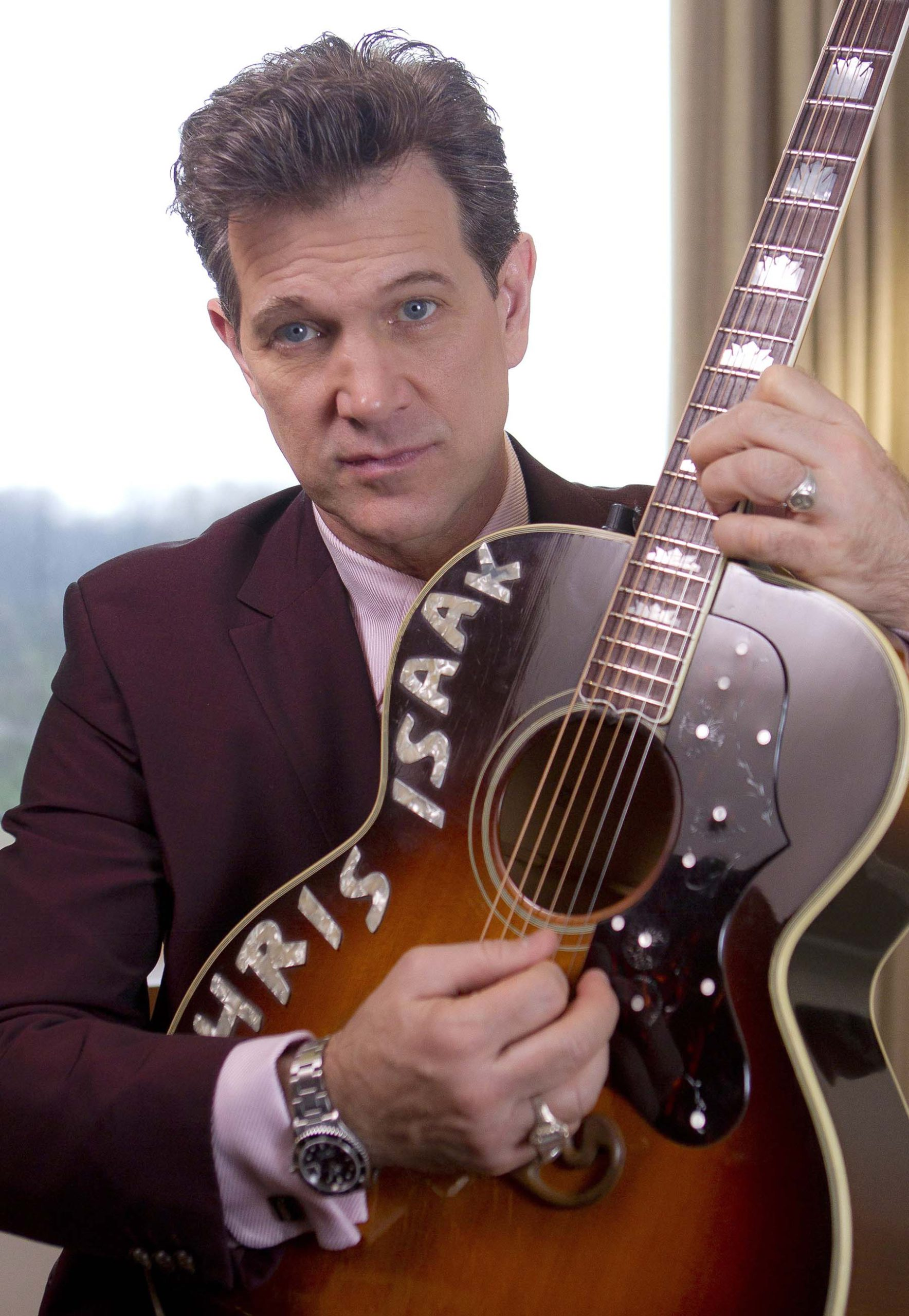 The 64-year old son of father (?) and mother(?) Chris Isaak in 2021 photo. Chris Isaak earned a  million dollar salary - leaving the net worth at  million in 2021