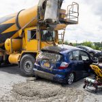 Car and cement truck collide Tuesday in Schenectady; Car driver injured, wet cement sent onto car