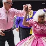 Dozens of square dancers gather to celebrate friend's belated birthday