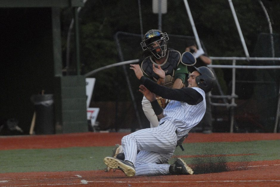 Riley Mahan of the Amsterdam Mohawks is tagged out by Mohawk Valley catcher Chris Rave during Monday night's Perfect Game Collegiate Baseball League game at Shuttleworth Park in Amsterdam..