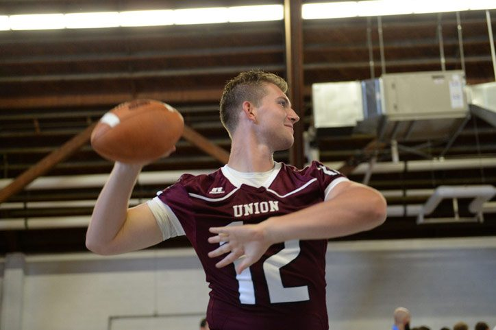 Dante Cioffi (12) passes a football during the Union College Football Media Day on Tuesday, August 18, 2015.