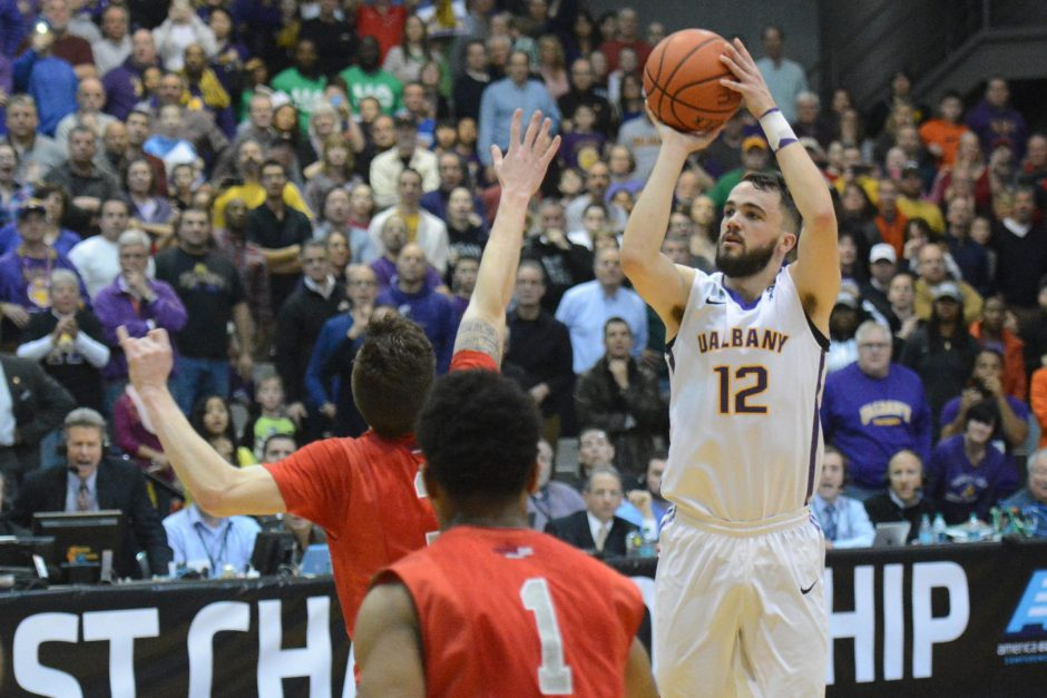 Years before Peter Hooley (12) hit this buzzer beater against Stony Brook in March to send SEFCU Arena into a frenzy and UAlbany back to the NCAAs, he sent blind emails to American colleges, including The College of Saint Rose, seeking a chance to play.