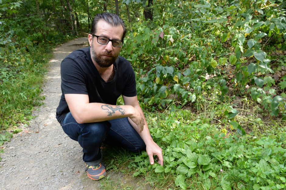 Musician Sean Rowe poses for a picture while foraging for food at the East Greenbush Town Park on Friday.