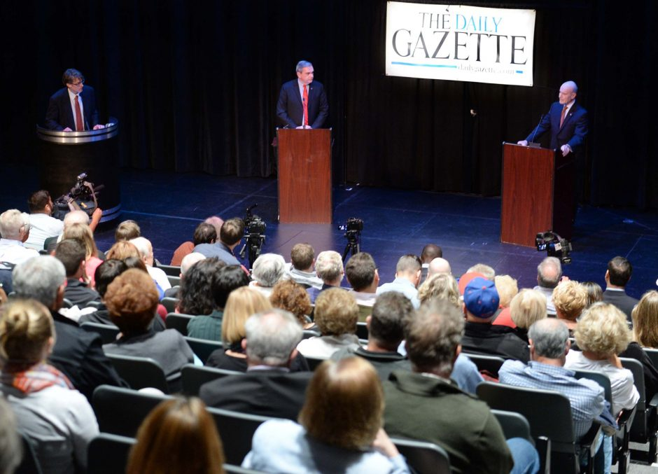 The Daily Gazette Managing Editor Miles Reed mediates a debate between Schenectady Mayor Gary McCarthy and Mayoral candidate Roger Hull in the GE Theatre at Proctors Wednesday, October 7, 2015.