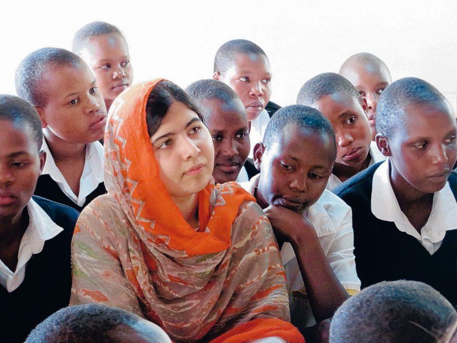 Malala Yousafzai (in red) at the Kisaruni Girls School in Massai Mara, Kenya.
