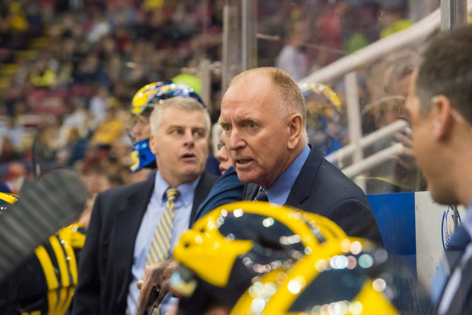 University of Michigan coach Red Berenson talks to his players during a Dec. 28, 2014 game against Michigan Tech. Berenson leads the Wolverines against Union tonight.