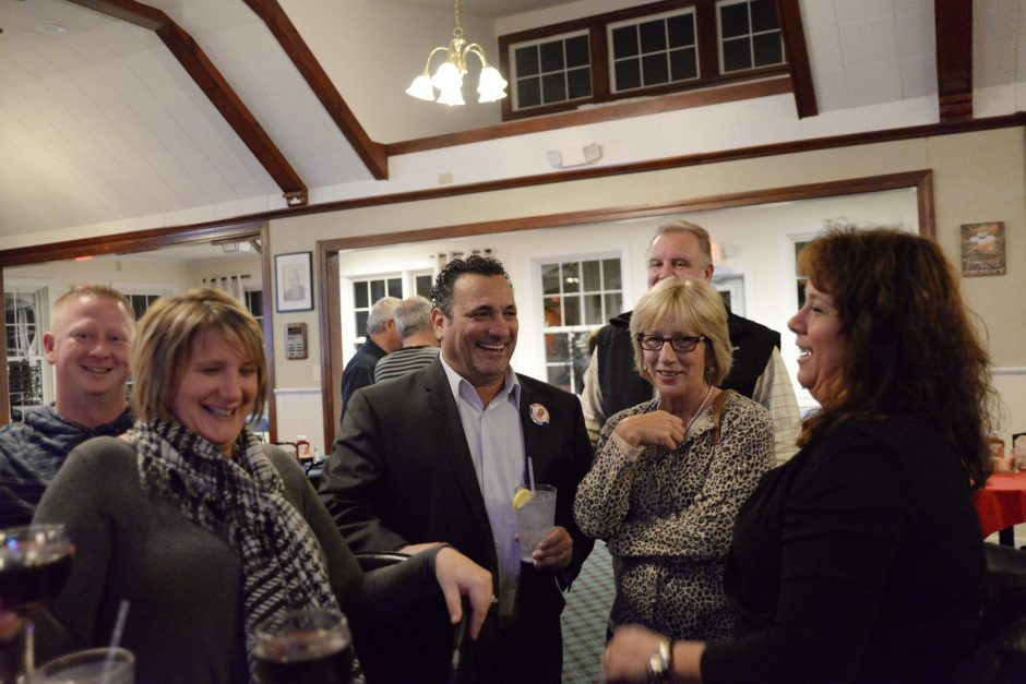 Republican Mike Villa with supporters Tuesday night at the Amsterdam Municipal Golf Course while awaiting election results. Villa later defeated incumbent Democrat Ann Thane.