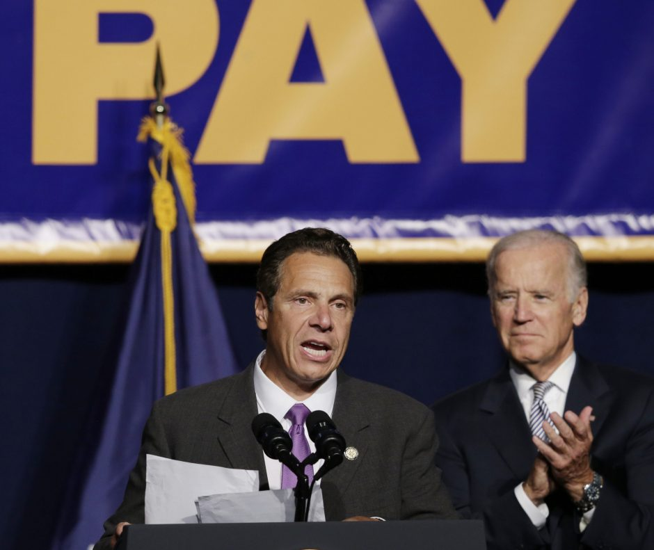 Vice President Joe Biden applauds as New York Gov. Andrew Cuomo speaks at a labor rally, Thursday, Sept. 10, 2015, in New York. Cuomo is proposing that the state minimum wage be raised to $15 an hour.