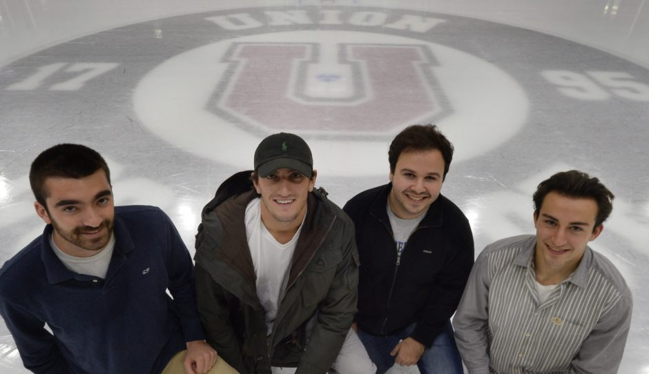 Union College students Matt Perillo, left, Sean Hanley, Steven Nadel, and Ryan Trembley kneel at center ice at Messa Rink Tuesday, November 10, 2015.