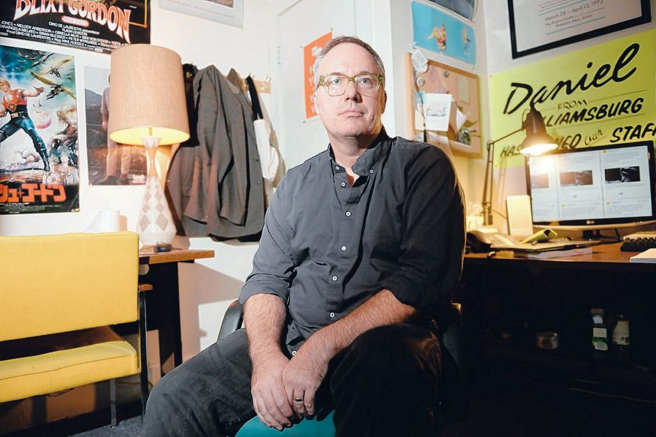 Author and professor Daniel Nester sits in his office at the College of Saint Rose in Albany. Nester's book, about growing up in a blue-collar town in New Jersey, is called 'Shader: 99 Notes on Car Washes, Making Out in Church, Grief, and Other Unlearn...