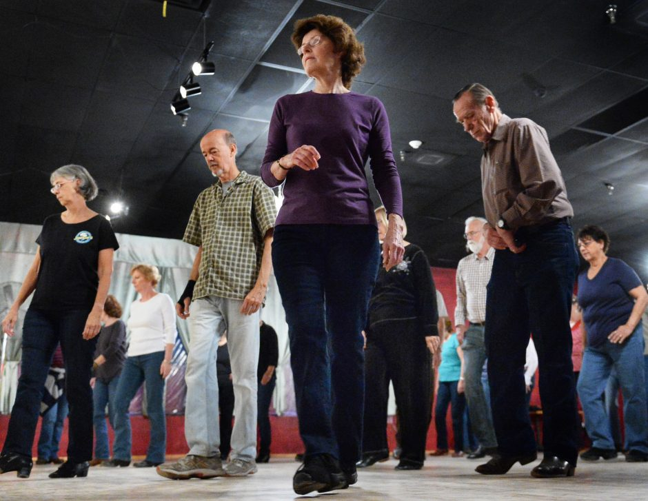 Participants learn line dancing steps at Danceland in Latham on a recent evening.
