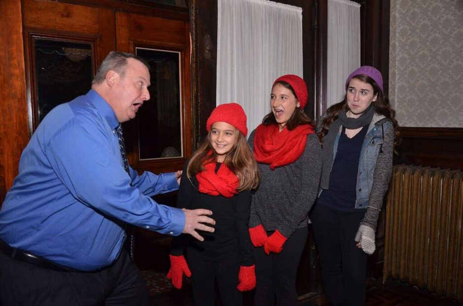 """Glenn Read, left, rehearses a scene with Kiera Lukasik, left, Caroline Lukasik and Julie Mahoney for the Classic Theater Guild production of """"A Radio Christmas Carol,"""" opening Friday at Proctors' Fenimore Gallery."""