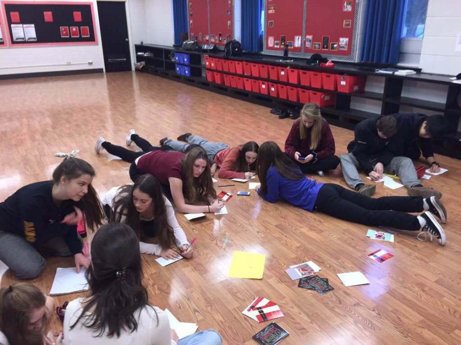 Andrea Lefebvre's high school dance class from North Bay, Ontario, takes time out Thursday to send Christmas cards to Sa'fyre Terry. They wrote the cards as part of their ongoing effort to help others, Lefebvre said. (Provided photo)