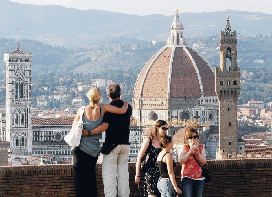 A couple visits the sights in Florence, Italy (The Associated Press)