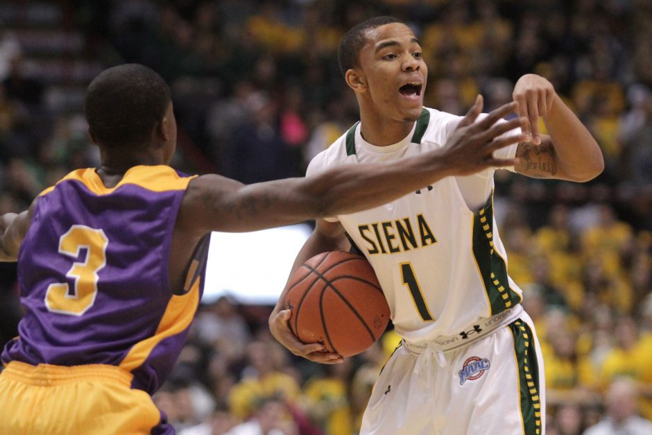 Siena's Marquis Wright (1) calls a play while Albany's DJ Evans (3) defends during the 2013 Albany Cup game at the Times Union Center in Albany.