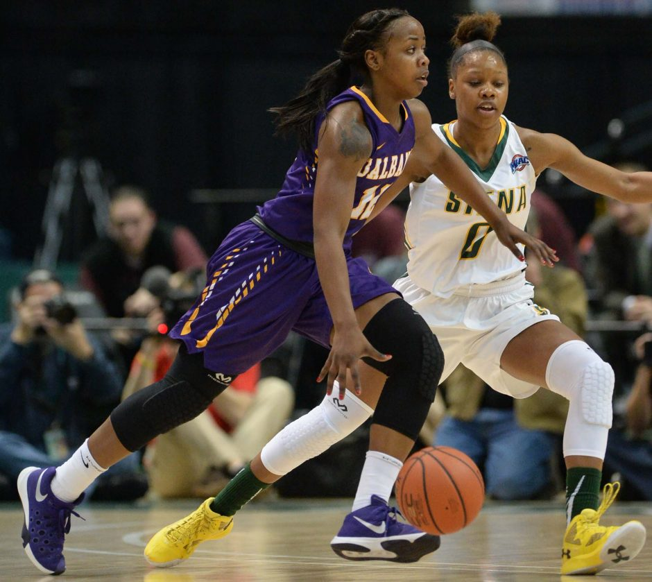 Imani Tate of UAlbany is guarded by Denisha Petty-Evans of Siena on Saturday at the Times Union Center.