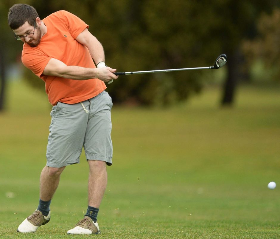Jake Coffey of Niskayuna takes a shot from the 1st fairway at Stadium Golf Course in Schenectady Thursday, December 24, 2015.
