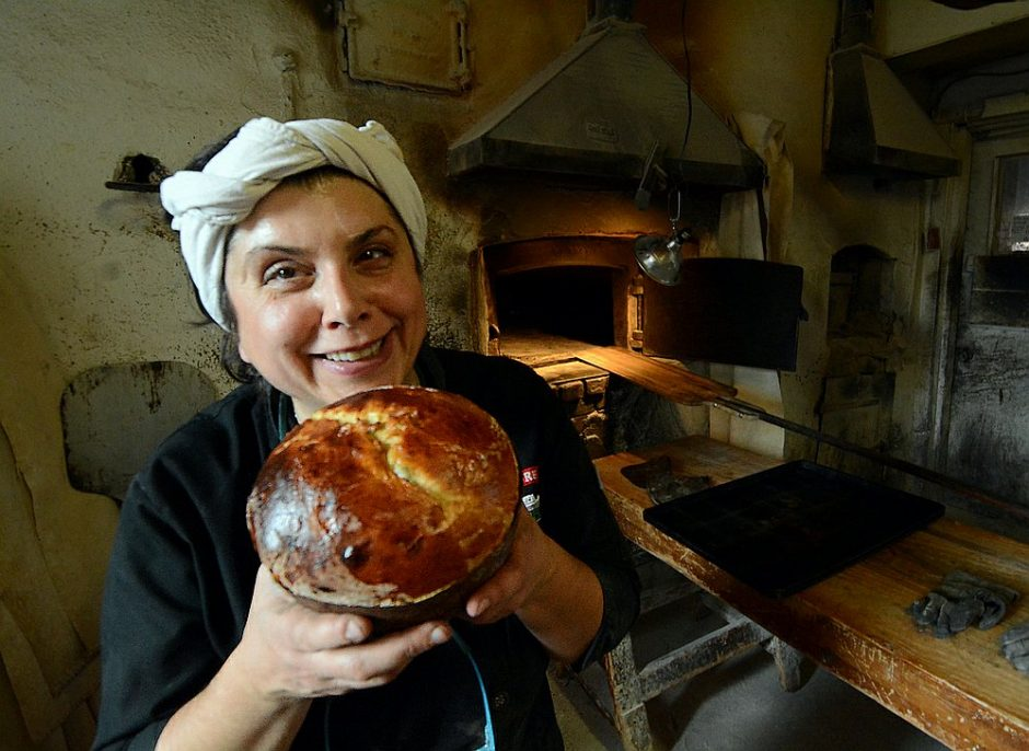 Perreca's Bakery co-owner Maria Perreca Pap holds a loaf of panettone earlier this month, after the baker was honored.