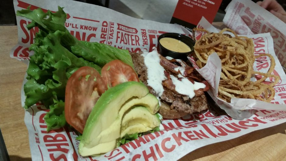 Smashburger's Avocado Club (avocado, Applewood smoked bacon, lettuce, tomato, ranch dressing and mayo on a multigrain bun), with a side of Haystack Onions. (Beverly M. Elander photo)