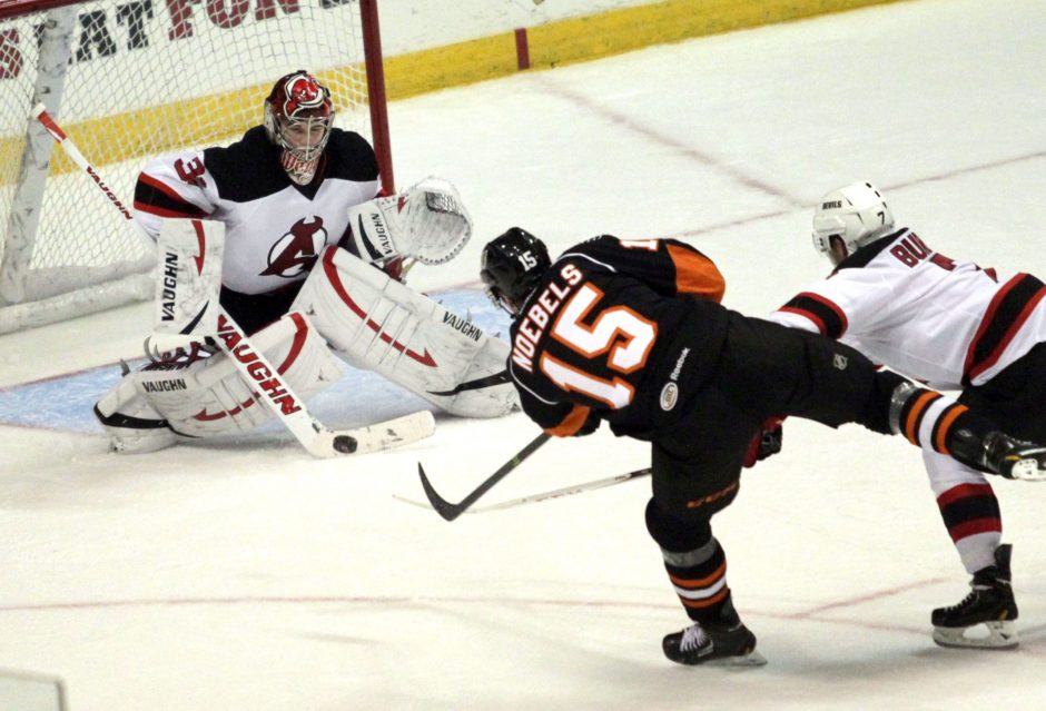 Since coming back from a preseason ankle injury, Albany Devils goaltender Scott Wedgewood, left, pictured from a game two season ago, is 4-1-0, including wins in his last three outings.