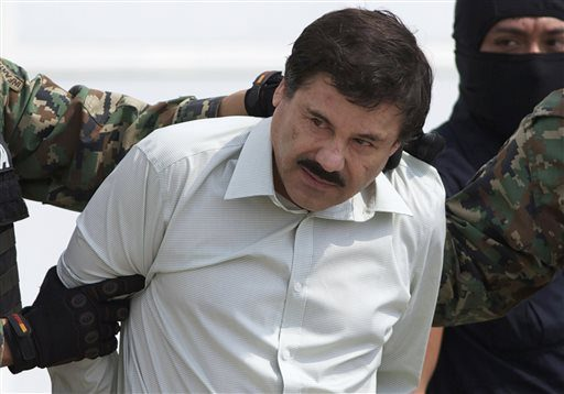 "In this Feb. 22, 2014, file photo, Joaquin ""El Chapo"" Guzman, head of Mexico's Sinaloa Cartel, is escorted to a helicopter in Mexico City, following his capture overnight in the beach resort town of Mazatlan. Mexico's security commission said in a stat..."