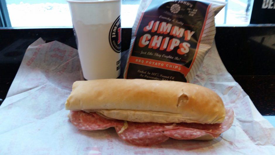 Italian sub with Genoa salami, capicola ham, Italian dressing, onion , lettuce and tomato.  And Jimmy's barbecue  chips. (Caroline Lee)