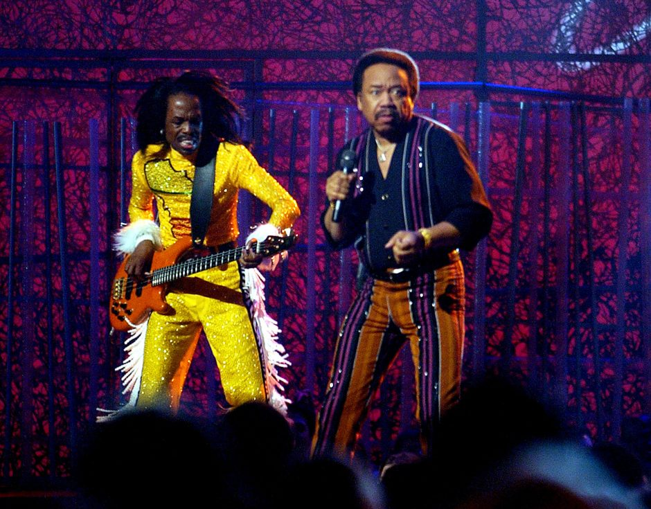 Guitarist Verdine White, left, and singer Maurice White of the group Earth, Wind and Fire perform during a tribute to funk at the 46th Annual Grammy Awards show in 2004. White died Wednesday at age 74.