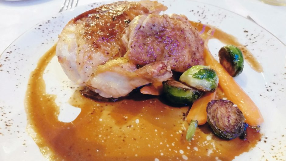 Wellington's seared  free-range  chicken with roasted vegetables and potato pancake. (Caroline Lee)