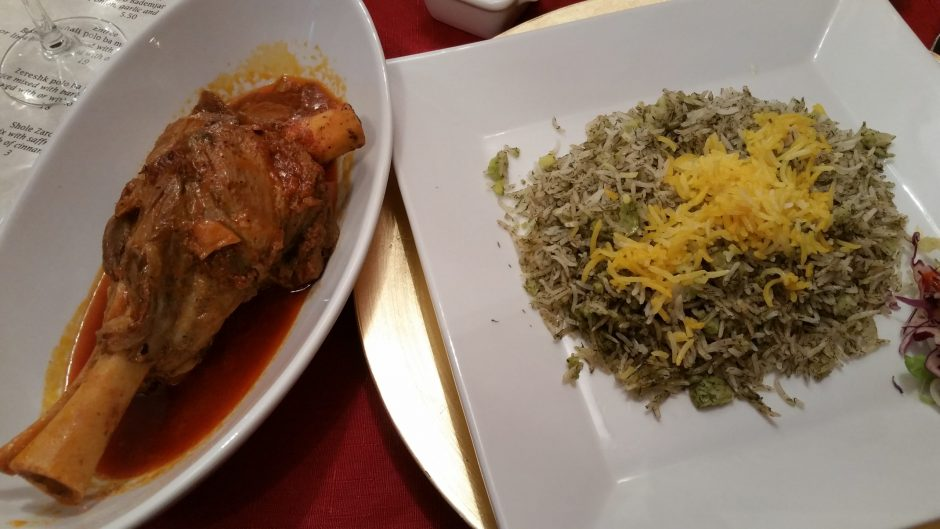 Persian Bite's Baghali polo ba mahicheh -- basmati rice, beans and lamb shank -- comes with shredded red cabbage and lettuce. (BEVERLY M. ELANDER PHOTO)
