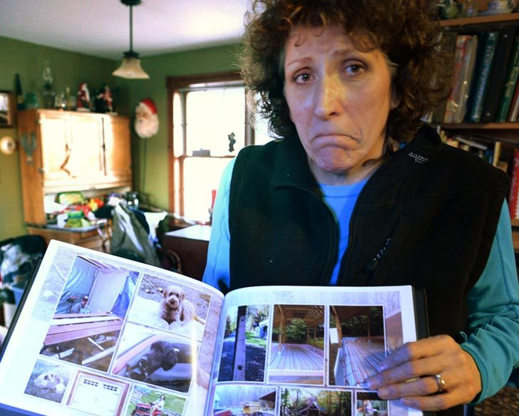 Denise Krohn of Florida on Thursday holds a picture of her two dogs killed when her house was broken into and ransacked.