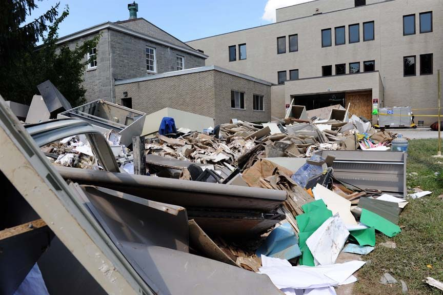 Debris from the interior is heaped outside the Schoharie County Office Building in downtown Schoharie after the building was flooded during Tropical Storm Irene.