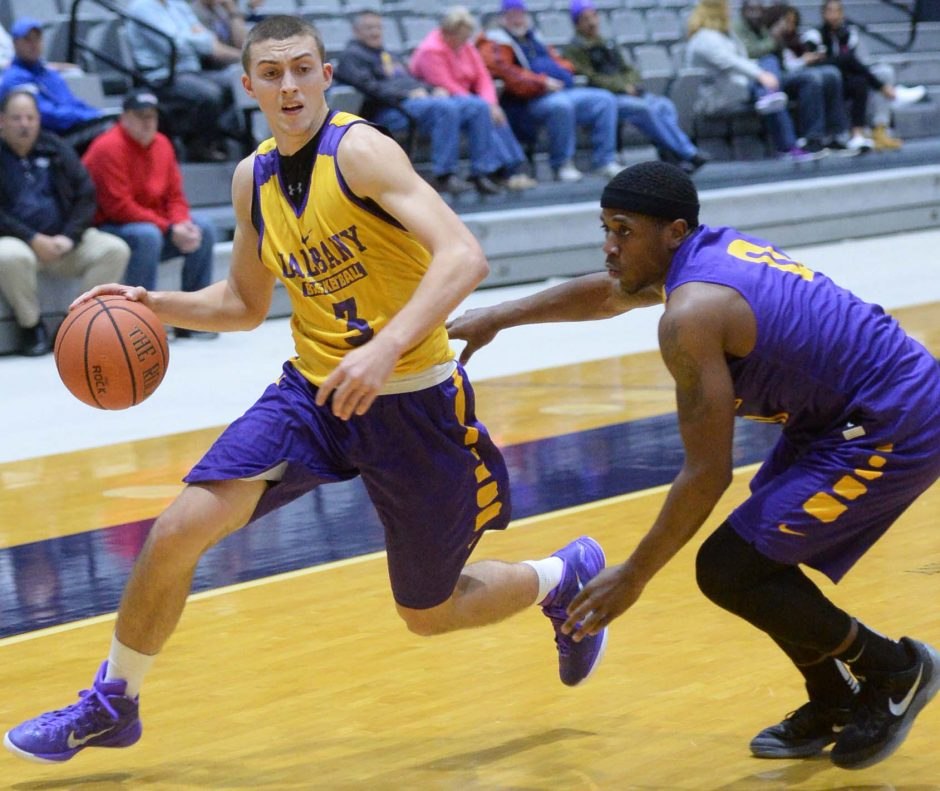 Joe Cremo of UAlbany looks for an open man while being guarded by Evan Singletary in the Purple Bowl inner squad scrimmage at SEFCU Arena Saturday, October 17, 2015.