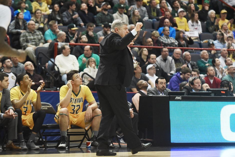 Siena coach Jimmy Patsos yells encouragement to his player during Sunday night's MAAC Tournament semfinal against Iona at Times Union Center.