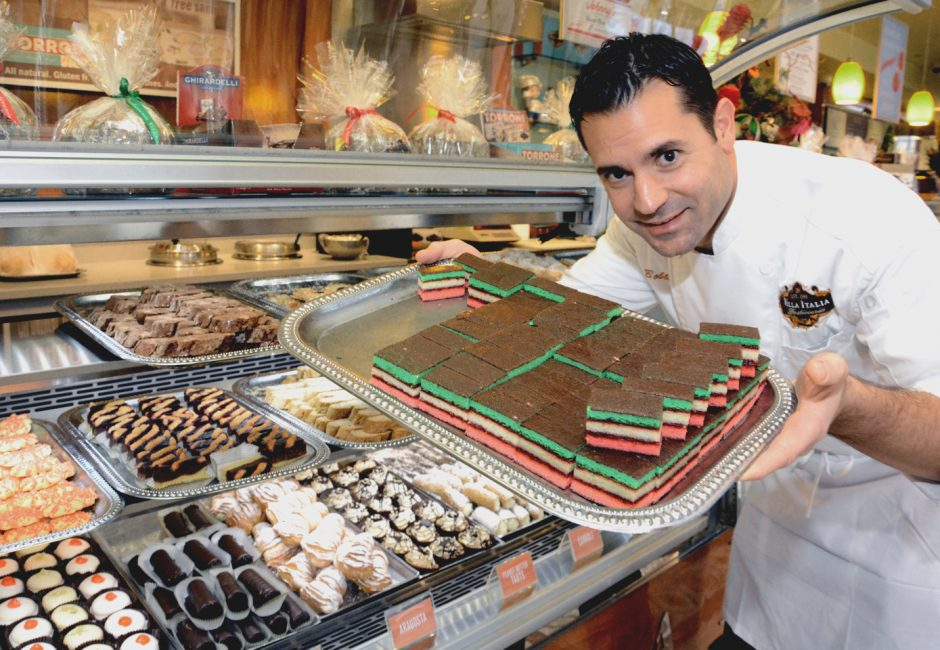 Bobby Mallozzi shows off tray of 7-layer Christmas cookies at the Villa Italia in this file photo.