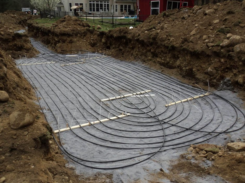 A closeup of an installation job by Aztech Geothermal. Here, a system of pipes are being installed at the bottom of a pond on a customer's property to harvest energy for a geothermal system.