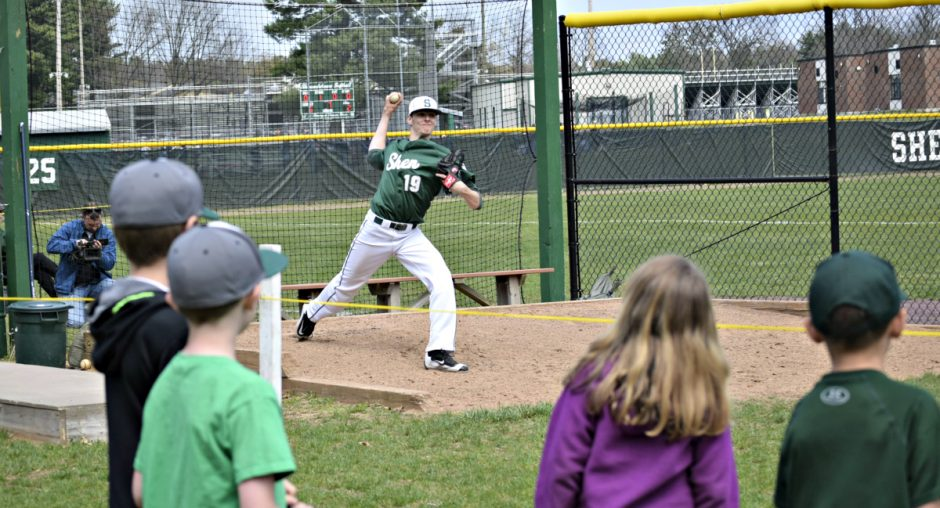 With some young fans watching, Shenendehowa pitcher Ian Anderson is shown warming up in the bullpen during a Friday baseball game in Clifton Park.
