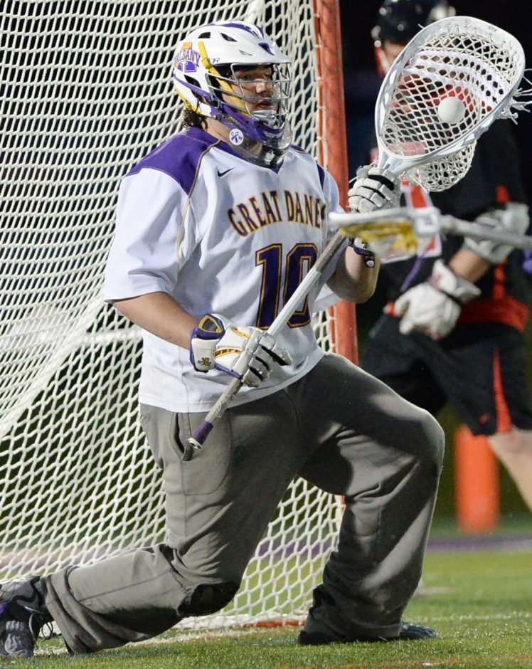 University at Albany goalie Blaze Riorden makes a stop in front of Hartford's Justin Huggins at Casey Stadium Thursday. Huggins scored the game-winner in overtime as the Hawks shocked the Great Danes 11-10 in the America East semifinals.