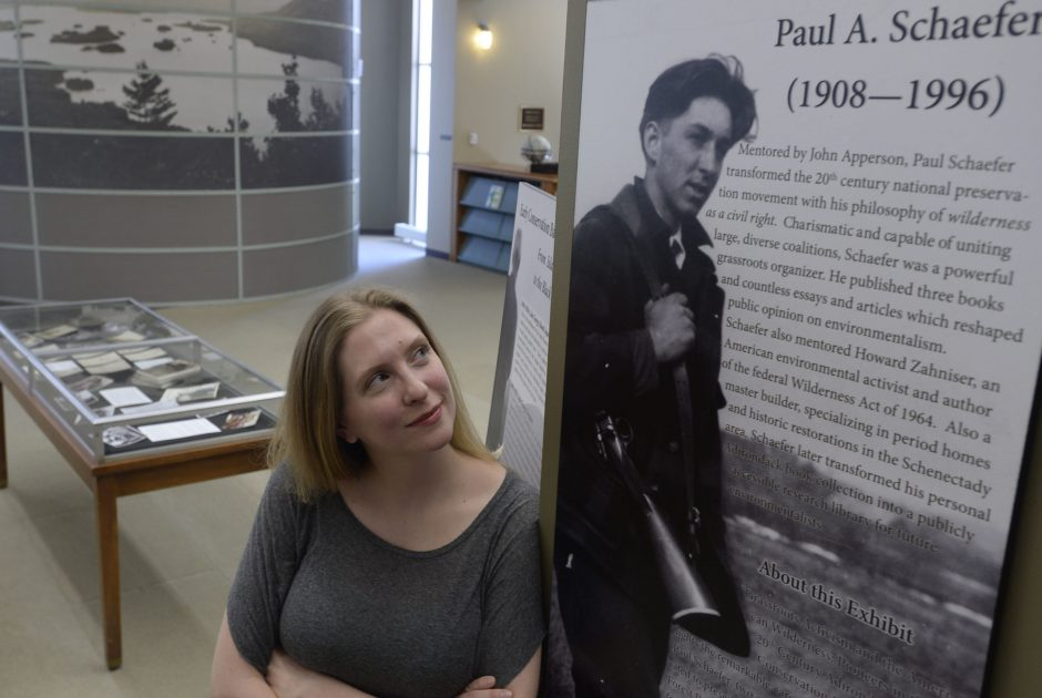 Abi Simkovic currator of the Adirondack Exhibit in the Schaffer Library at Union College looks up at photographer Paul Schaefer Wednesday, May 11, 2016.