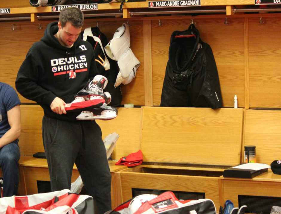 Albany Devils defenseman Marc-Andre Gragnani clears out his locker stall Thursday as the team packs up at the conclusion of the season.