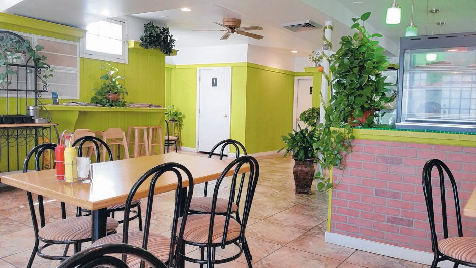Lime green walls and garlands of live philodendron mark the Cousin's Restaurant on Carrie Street in Schenectady. (Beverly M. Elander photo)