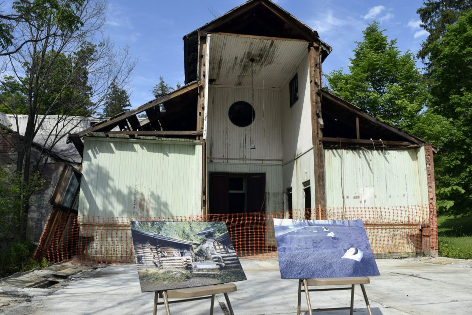 Photos of planned renovations sit in front of a run-down portion of the Imperial Bath & Spa in Sharon Springs on Wednesday June 1, 2016.