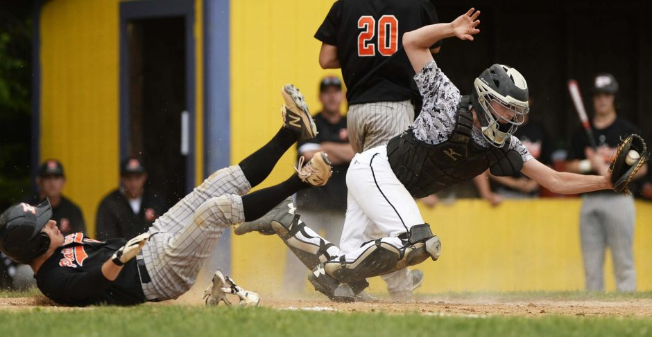 Schalmont catcher Tony Silvestri tags out Andrew Bechard of Plattsburgh as he tries to steal home in the regional semifinal Thursday at Ballston Spa High School. Schalmont won 5-2, and will play in the regional final Saturday.