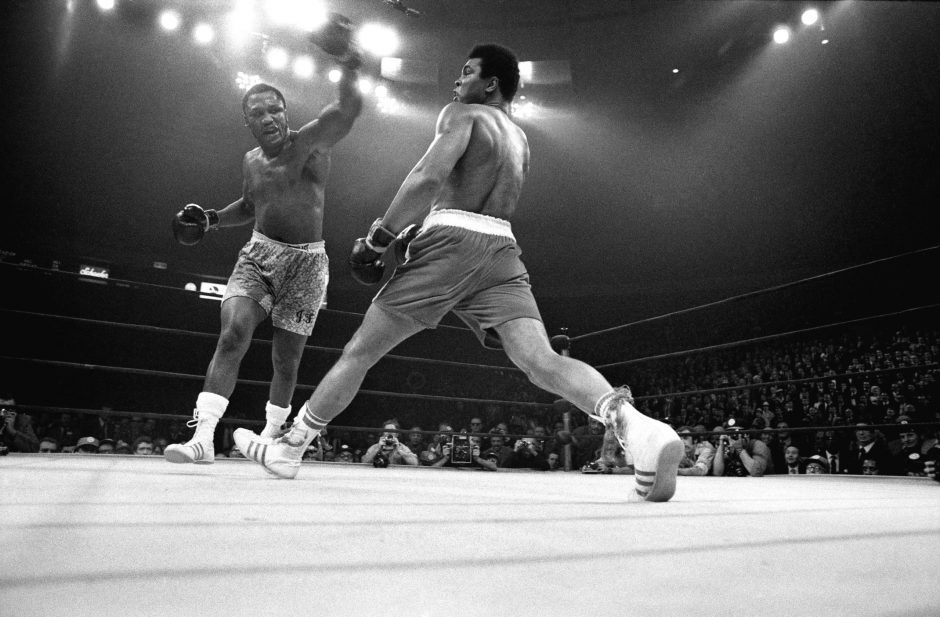 Muhammad Ali evades a left from Joe Frazier during their title bout, the 'Fight of the Century,' at Madison Square Garden in New York, March 8, 1971. Five years after being stripped of his titles for refusing to register for the draft, Ali suffered the...