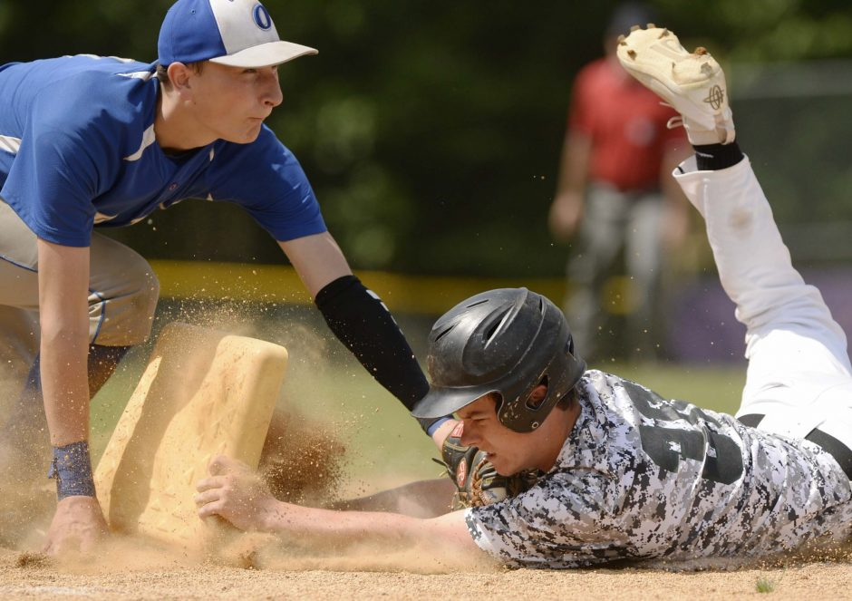 Matt Rash of Schalmont beats the tag at first base by Andrew Layng of Ogdensburg Free Academy Saturday. Schalmont won 9-0.