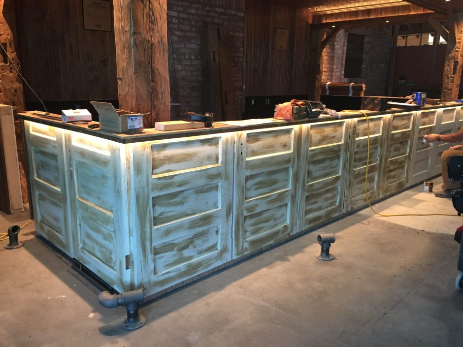 The bar at the new Glass Tavern Restaurant at Socha Plaza 115 in Glenville, shown under construction last month, is being built of locally reclaimed materials. (Provided photo)