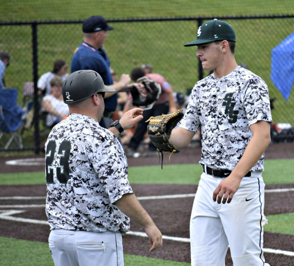 Schalmont head coach Chris Teta, left, greets pitcher Chris Hamilton after the first inning during the Class B baseball state semifinal game against Fredonia in Endwell. Fredonia won 4-2.