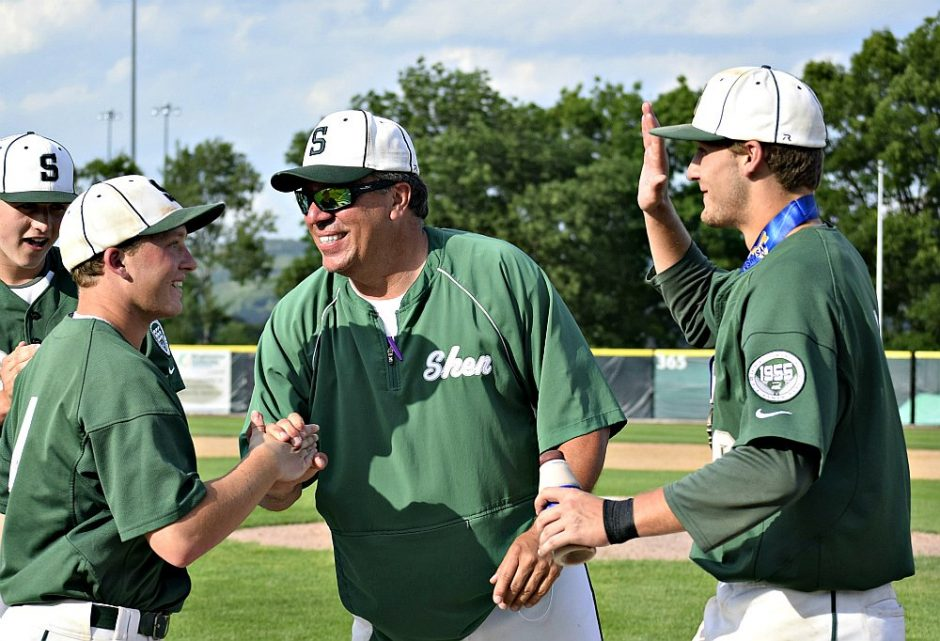 Shenendehowa's Jpoe Palko, left, is congratulated by head coach Greg Christodulu after his hit won the Plainsmen their first state Class AA baseball championship last weekend.
