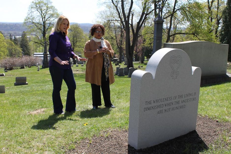 St. Agnes Cemetery historian Kelly Grimaldi, left, and Evelyn Kamili King, director of the Schuyler Flatts African Burial Ground Project, look at the gravestone which will mark the remains of 14 slaves.