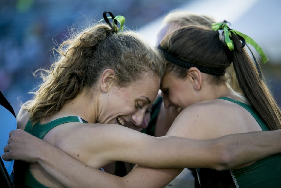 Hannah Reale and Danielle Jordan, foreground, and Emily Crounse and Julia Zachgo, obscured, of the Shenendehowa 4x800-meter relay team are shown after winning a national championship this past weekend in North Carolina.