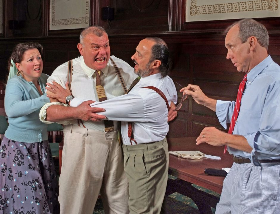 """Joel Aroeste as Juror No. 3, second from left, lunges at Juror No. 8, right, played by David Bunce as tempers flare in the classic story of """"Twelve Angry Jurors†at the New York State Theatre Institute at the Schacht Fi"""